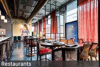 Rooh San Francisco selected vibrant paprika ripple fold drapes to coordinate with the restaurant decor.