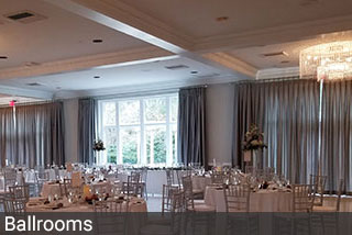 The North House. An elegant wedding venue in Connecticut, updated the ballroom with stunning inverted pleat drapes.